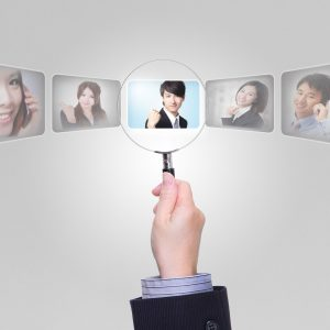 17542375 - human resources concept - job search and career choice employment with magnifying glass, asian model